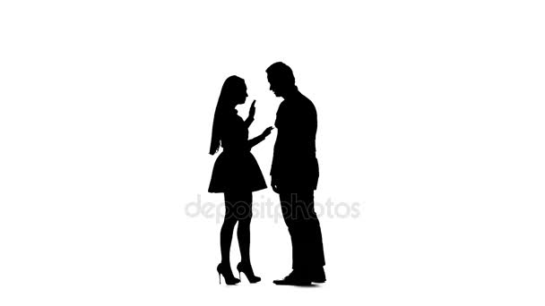 Husband and wife scold themselves, he screams, she cries. Silhouette. White background. Slow motion