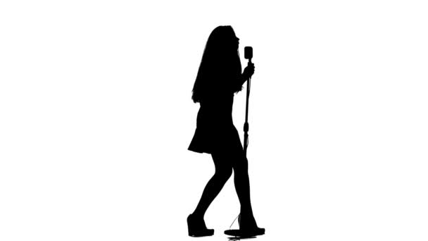 Photo Singer performs her song of authorship. White background. Silhouette