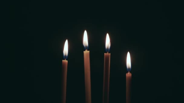 Candles are burning, and spinning on the table. Black background