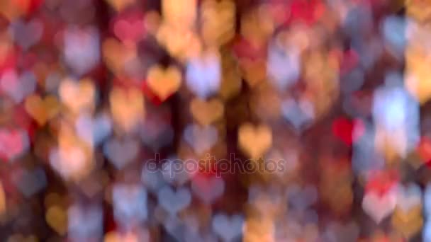 Jemná červená, žlutá, modrá světla srdíčkové pozadí abstraktní bokeh