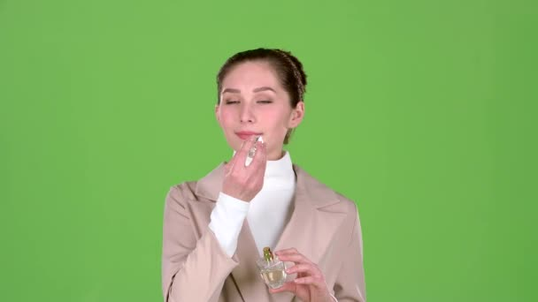 Seller of cosmetics advertises a pleasant fragrance of perfume. Green screen