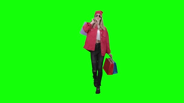 Girl is going shopping with a lot of packages . Green screen