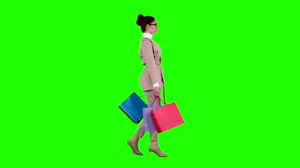 Girl goes shopping in the store. Green screen. Slow motion