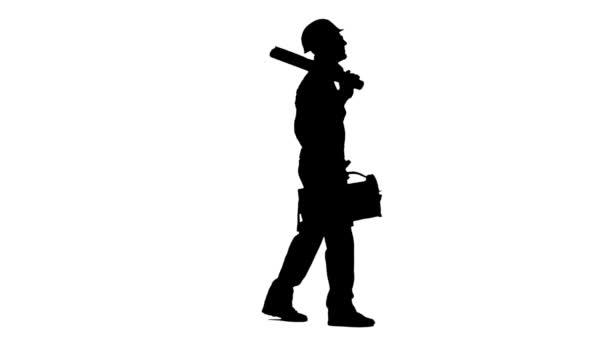 Tvůrce přináší nástroje pro stavebnictví a výkres v kufru. Bílé pozadí. Silueta. Boční pohled