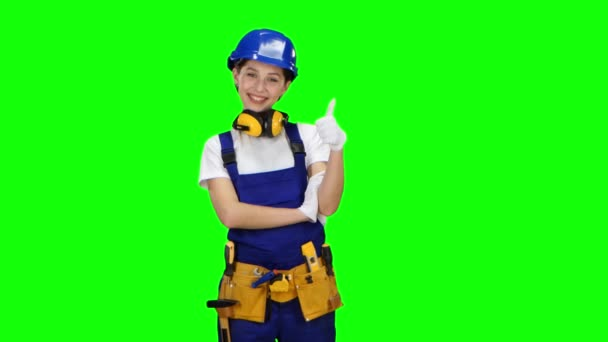 Construction worker girl showing thumbs up. Green screen