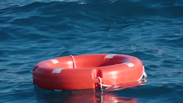 Life buoy or rescue buoy floating on sea to rescue people from drowning man. Slow motion. Close up