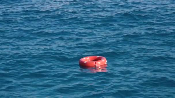 Life buoy or rescue buoy floating on sea to rescue people from drowning man. Slow motion