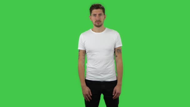 Confident guy is looking straight. Green screen