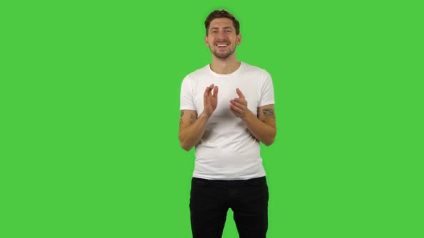 Confident guy is clapping his hands with wow happy joy and delight. Green screen