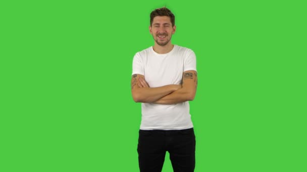 Confident guy is listening attentively, nodding his head and laughing. Green screen