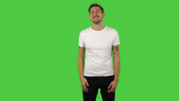 Confident guy is waving hand and showing gesture come here. Green screen