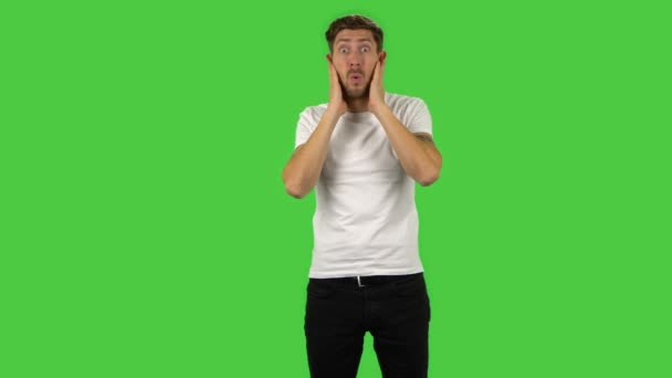 Confident guy with shocked surprised wow face expression. Green screen
