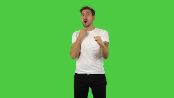 Confident guy with shocked surprised wow face expression is rejoicing. Green screen