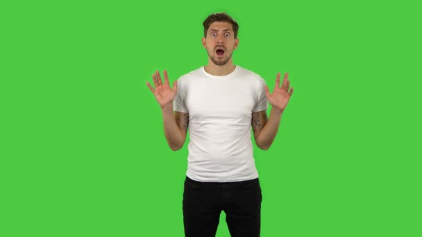 Confident frustrated guy is saying wow with shocked facial expression. Green screen