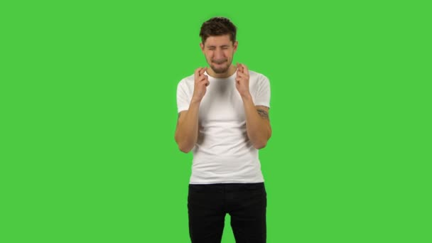 Confident guy is looking at the camera with excitement, then celebrating his victory triumph. Green screen