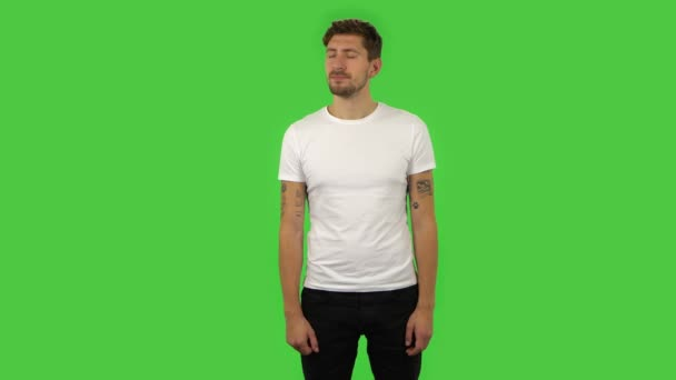 Confident disappointed guy looking at camera. Green screen