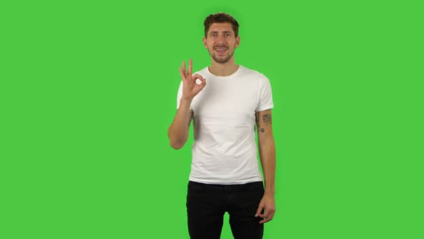 Confident guy is making sign ok. Green screen