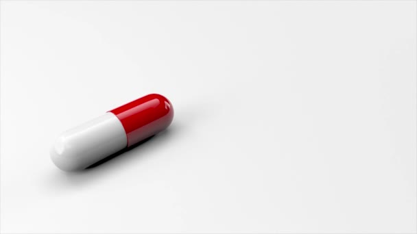 Eine weiß-rote pharmazeutische Kapsel in Nahaufnahme auf weißem Hintergrund. Rotierendes 3D-Rendering. Animation im Cartoonstil mit Kopierraum