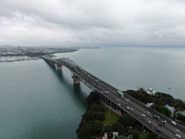 Viaduct Harbour, Auckland / New Zealand - December 30, 2019: The Amazing Auckland Harbour Bridge, the marina bay, beaches, and the general cityscape of Auckland New Zealand
