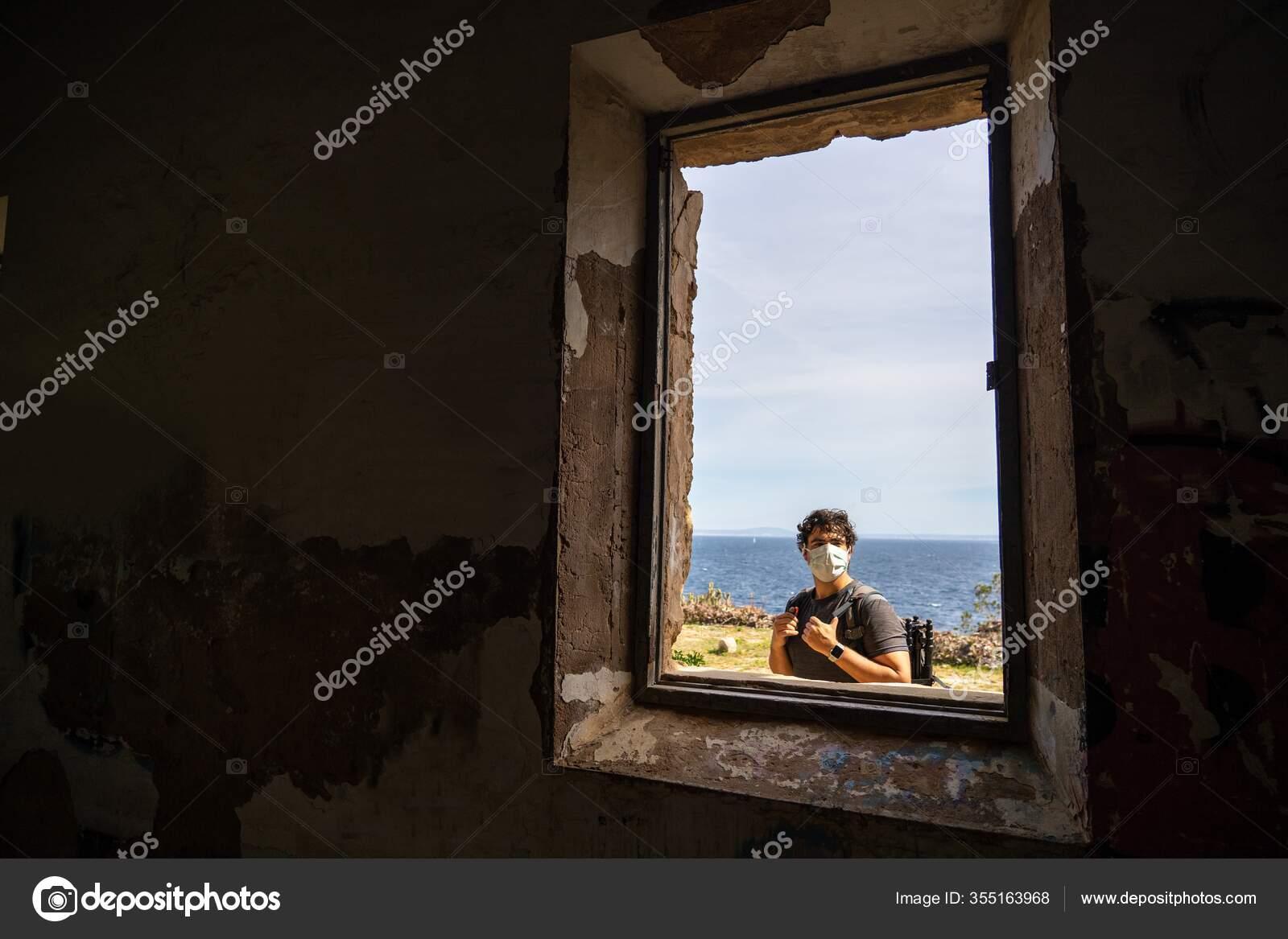 View Window Abandoned Building Man Mask His Face Bag Facing Stock Photo C Daniskim 355163968