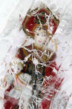 Russian doll in ice block
