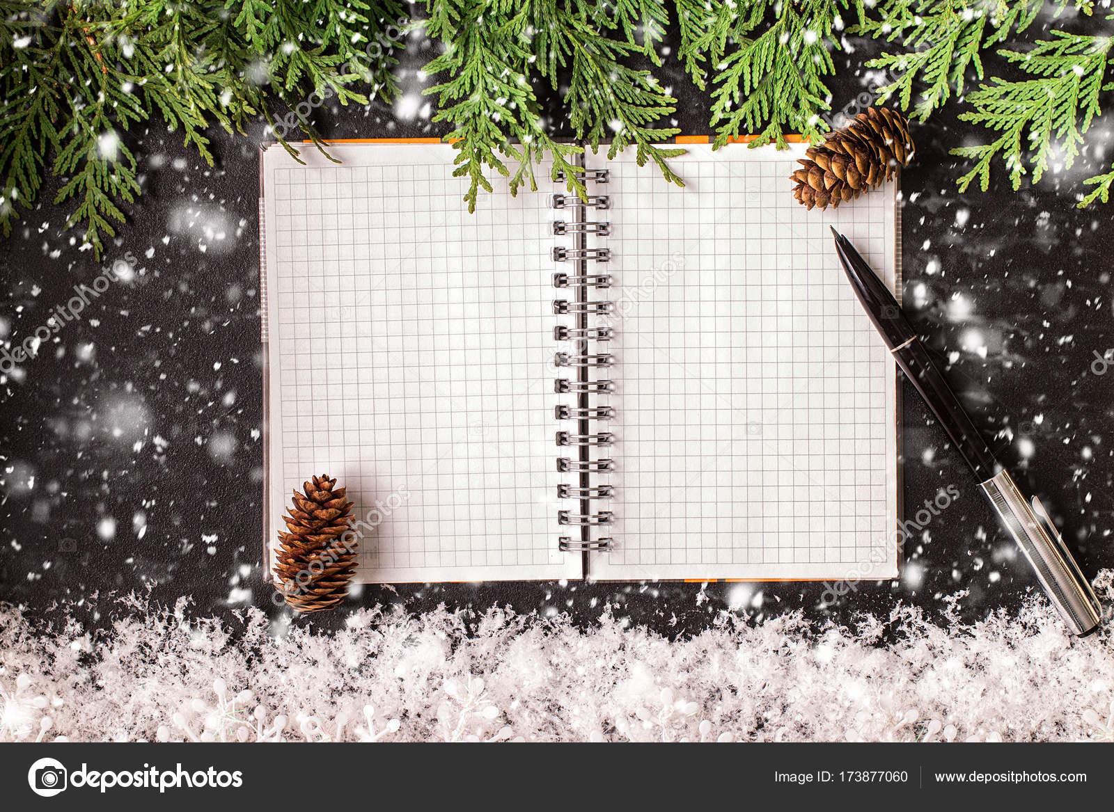 Christmas ornaments and an open blank notebook on a chalkboard– stock image