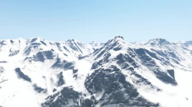 Aerial shot of snowy mountains and clear sky