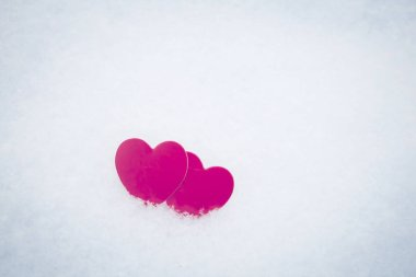 Red textile two hearts on snow, close up photo, romantic, love background for Valentine`s day. stock vector