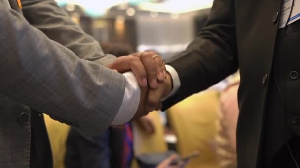 Two men shake hands at a business conference. Respect, deal