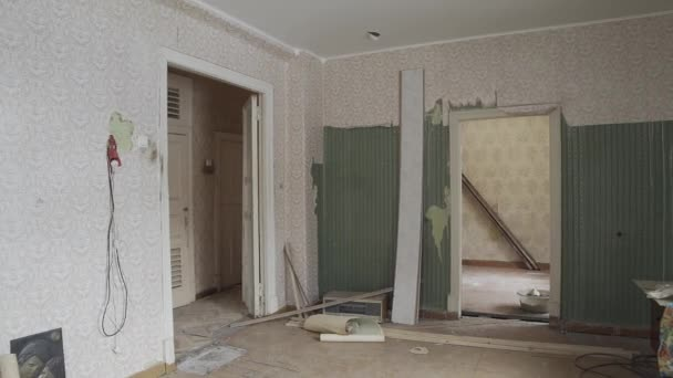 Repair in the apartment. Old abandoned room. Torn wallpaper, dirty carpets