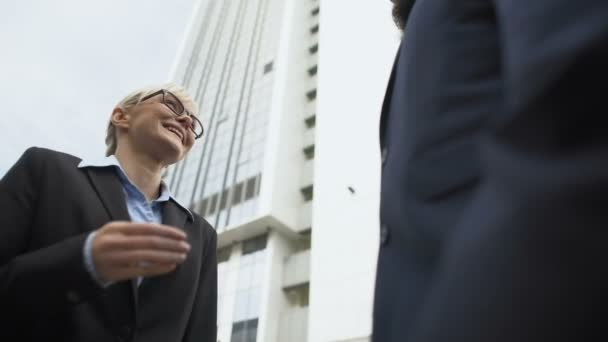 Businesswoman shaking hands with male partner, successful promotion interview