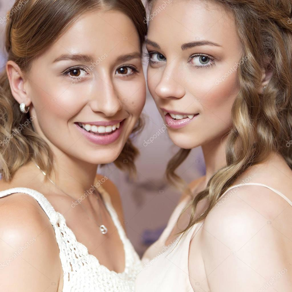 Two beautiful brunette bride women with curly hairstyle
