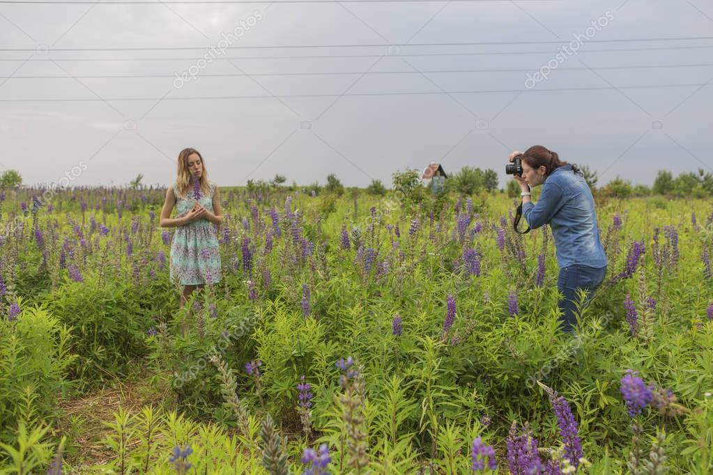 Photographer shoots Beautiful brunette fit slim fragile woman wi