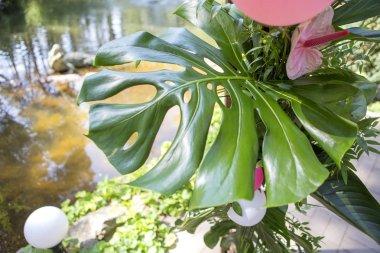 Pink fake flamingo wedding decoration with anthurium flowers and