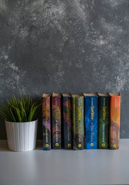 a series of books about Harry Potter in the Russian translation is on the table