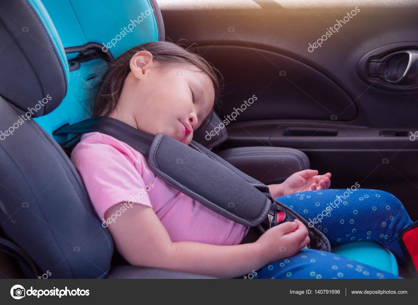 Girl Sleeping On Car Seat Stock Photo