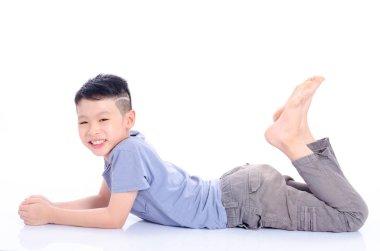 boy lying down on the floor over white