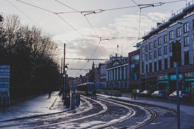 Dublin city centre wet street next to St Stephen Green park and