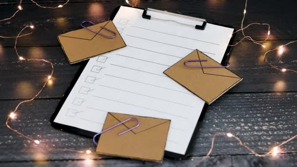 productivity and business schedules conceptual video, hand placing pencil next to email icons on top of to do list on clipboard