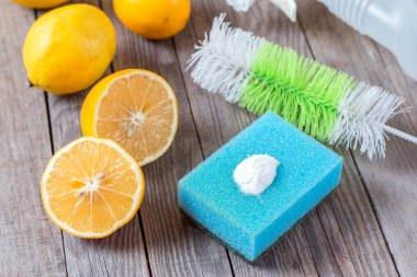 Eco-friendly natural cleaners baking soda, lemon and cloth on wooden table Homemade green cleaning