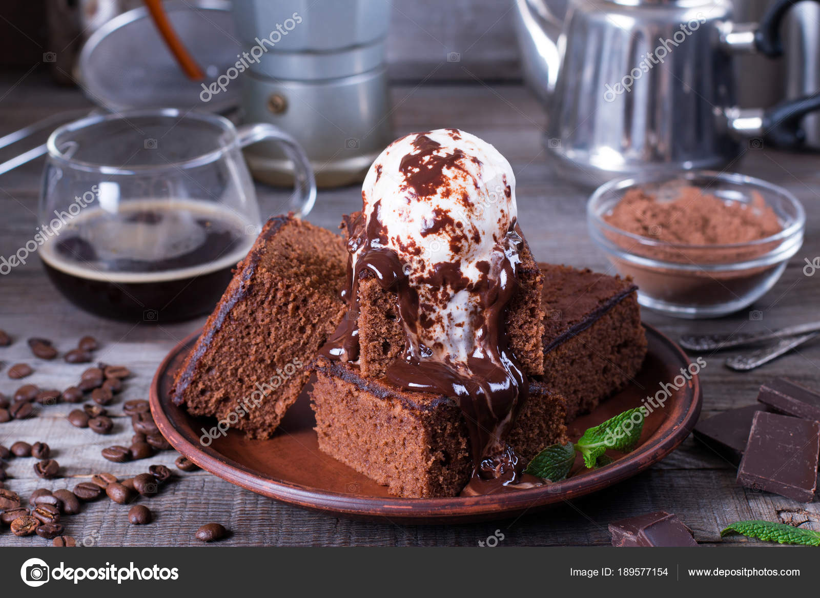 Homemade Brownies With Ice Cream On Top And Chocolate Sauce Are