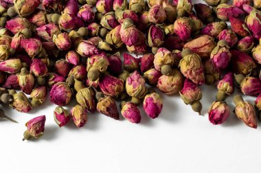 red and pink rose buds tea on white banner