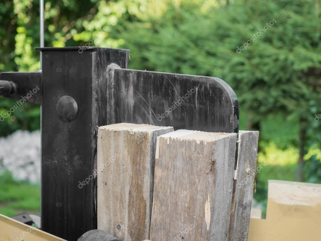 Firewood split with wooden splitter