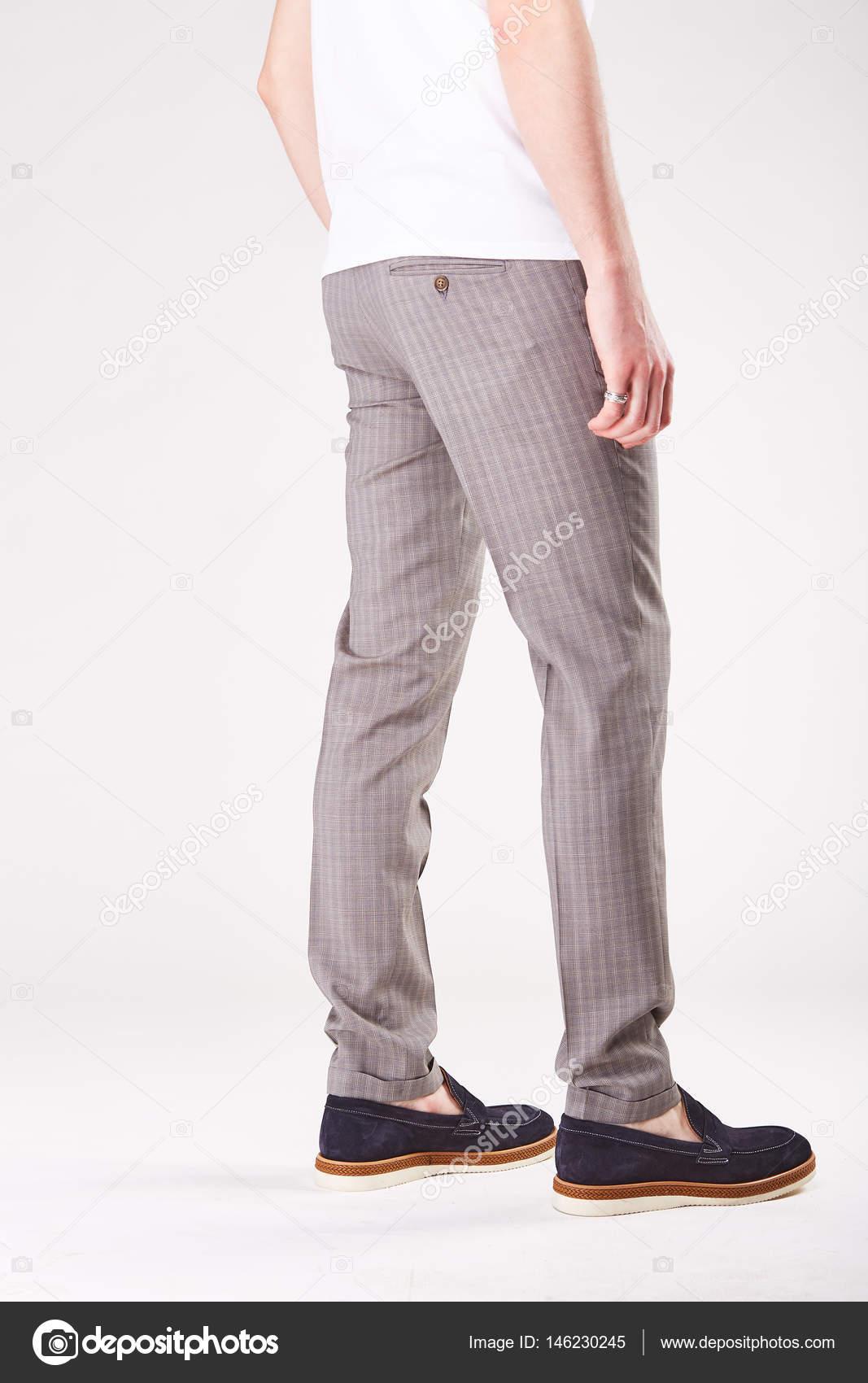 Man Is Posing In Light Studio In Trendy Grey Trousers And Black