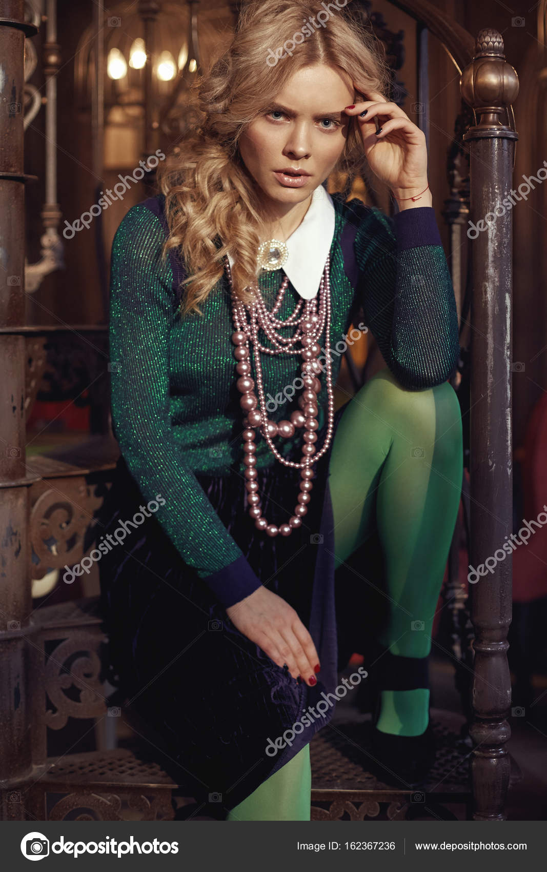 ead3a3a671 Young beautiful magical serious blonde curly woman with pearl necklace