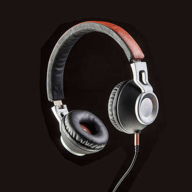 Clear picture of modern headphones with brown rim, soft black phones and slim black wire, made in studio with black backgroClear picture of modern headphones with brown rim, soft black phones and slim black wire, made in studio with black background