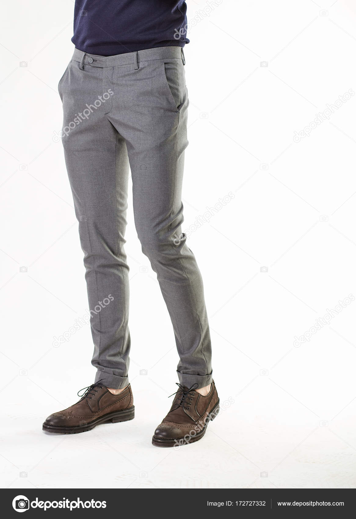 Man Model Posing In Gray Pants And Brown Shoes In Light Studio