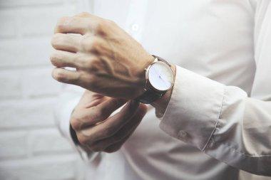 man hand watch