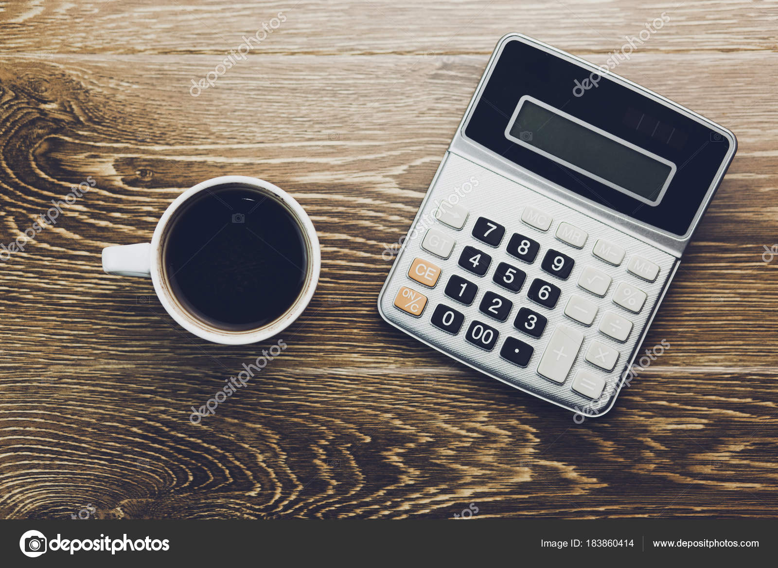 Calculator And Coffee On Table Stock Photo C Tiko0305 183860414