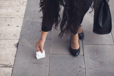 Woman Picking Up money